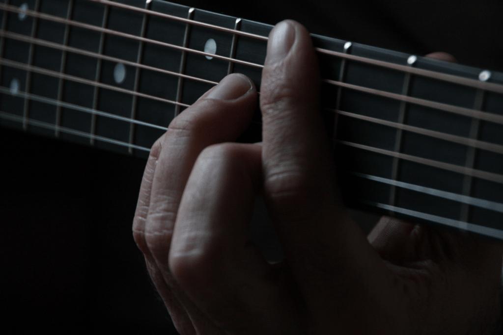 Fingers on a fretboard