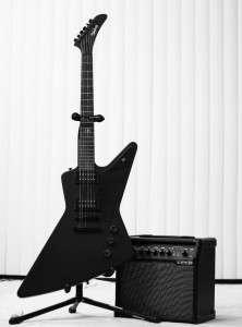 Electric guitar next to an amplifier